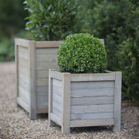 outdoor wooden planters 17 best ideas about wooden planters on wooden