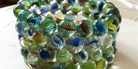 marble crafts for how she makes a prism candle holder out of marbles