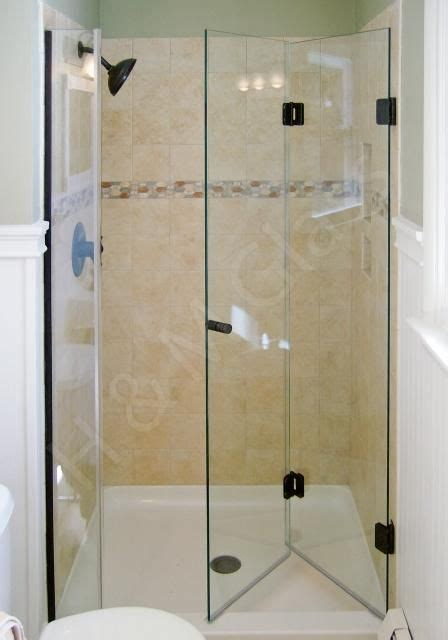 bi fold shower door frameless bi fold frameless shower door add stationary panel or