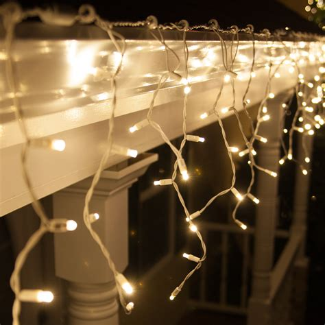 and white icicle lights 70 5mm led icicle lights warm white white wire yard envy