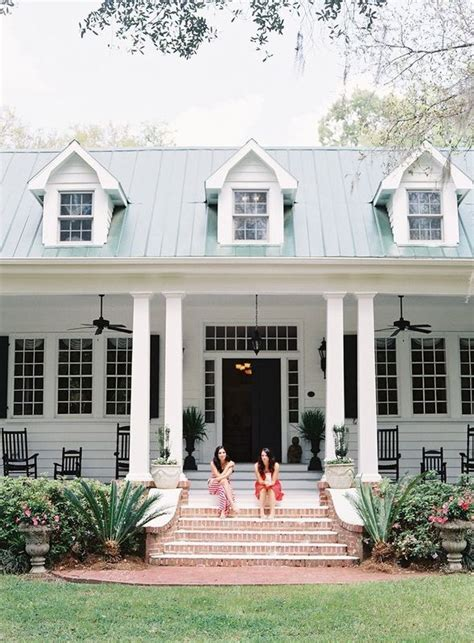 houses with big porches two sitting on front porch of plantation home http