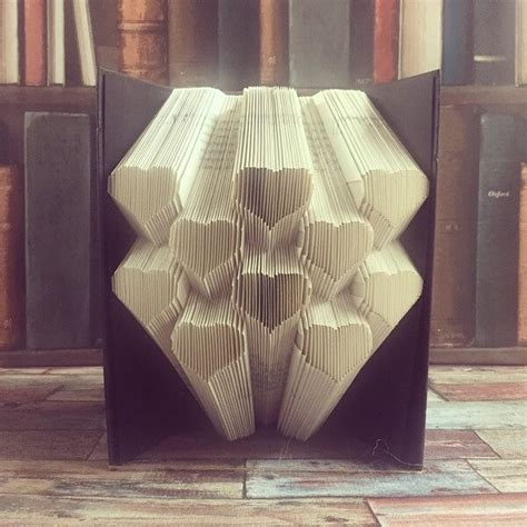 book origami patterns by carefully folding their pages artist turns books