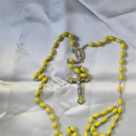 plastic rosary yellow plastic rosary shrine of the infant jesus