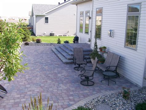 paver patio edging gray paver patio with edging rocks and plants oasis