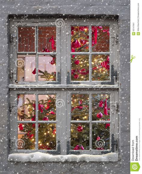 window tree with lights window snowfall and tree stock photo image