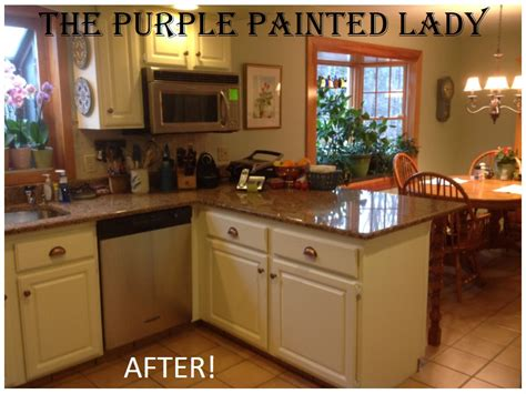 spray painting kitchen cabinets before and after do your kitchen cabinets look tired the purple painted