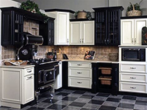 pictures of kitchens with white cabinets and black appliances venturing to the side of cabinets hgtv