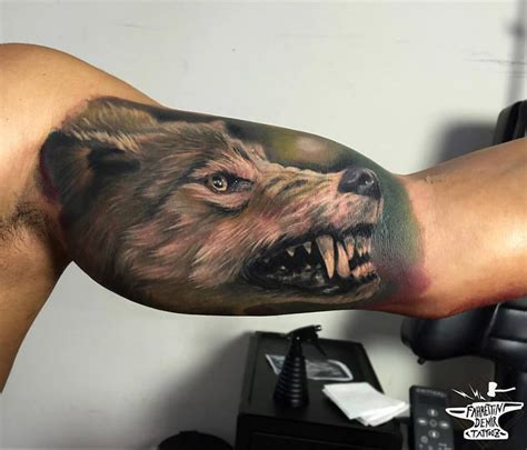 snarling wolf on guys bicep best tattoo ideas amp designs