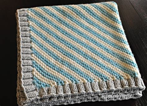 knitting stripes in the toppled turtle bias striped knit baby blanket free pattern