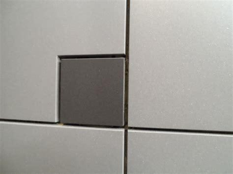 bathroom light switch tile