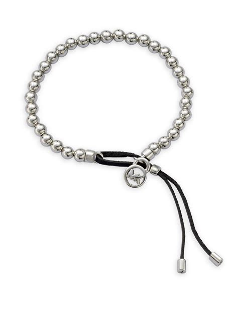 michael kors beaded bracelet uk michael kors logo plaque bead bracelet in metallic lyst