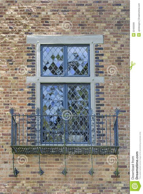 Free A Frame House Plans tudor style windows with balcony royalty free stock images