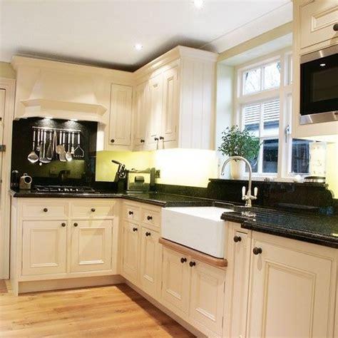 l shaped kitchen cabinet design delonghi distinta eci341 w coffee machine black