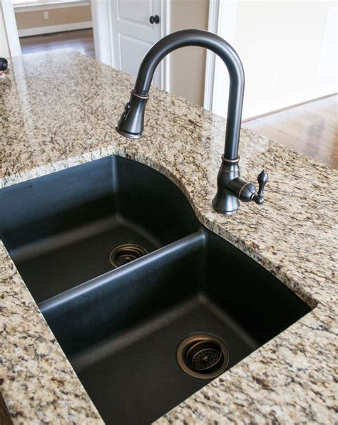 rubbed bronze kitchen sink faucet 25 best ideas about black kitchen sinks on