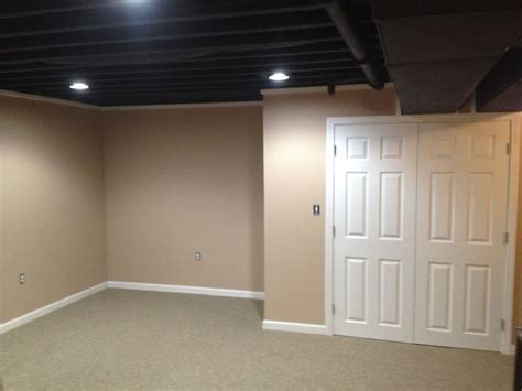 spray painting unfinished basement ceiling this exposed basement ceiling was spray painted black due