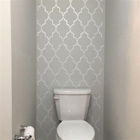 bathroom wall stencil ideas a diy silver and gray stenciled accent wall in a bathroom using the marrakech trellis stencil