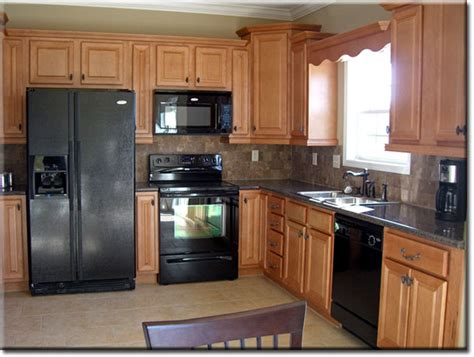black oak kitchen cabinets oak kitchen cabinets with black appliances smart home