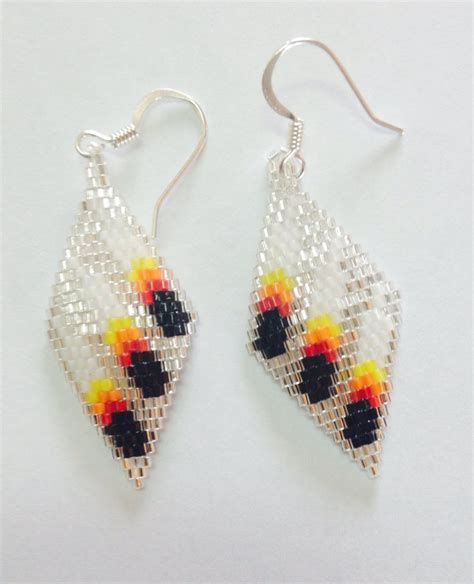 beaded earrings three feather beaded earrings