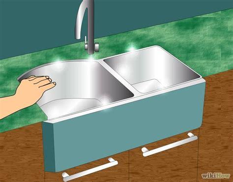 caulking around kitchen sink how to caulk the kitchen sink wikihow