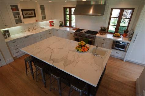 kitchen island with prep sink calcutta marble countertop contemporary kitchen