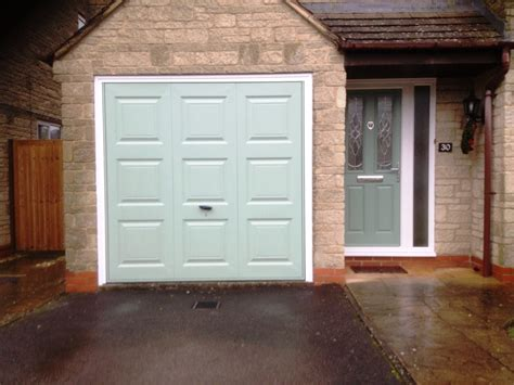green garage doors matching chartwell green garage and front door elite gd