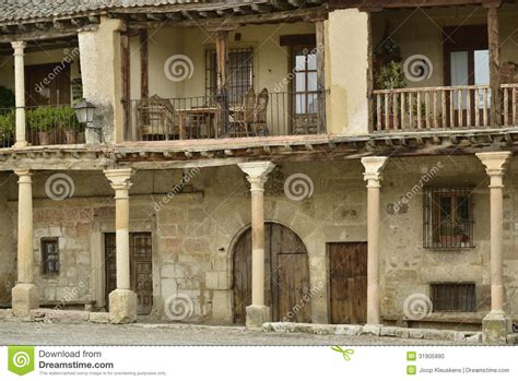 Plaza House Furniture old houses with balcony on pillars stock photo image