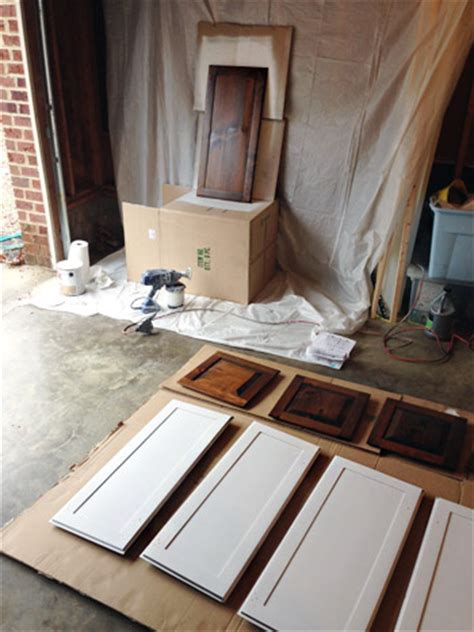 spray painting unfinished cabinets spraying doors