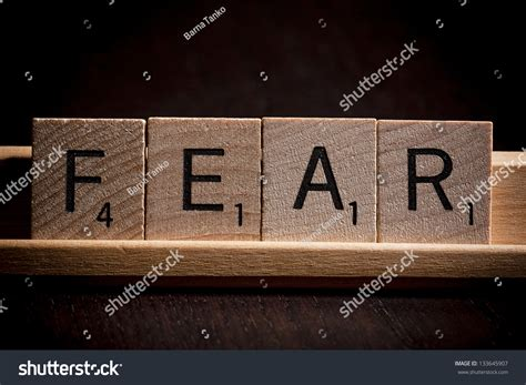 spell words with letters scrabble the word fear spelled by wooden scrabble letters stock