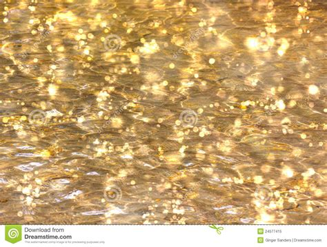 gold water shimmering gold water bokeh background royalty free stock