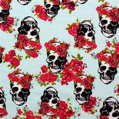skull knit fabric skulls and roses on aqua blue cotton spandex knit fabric