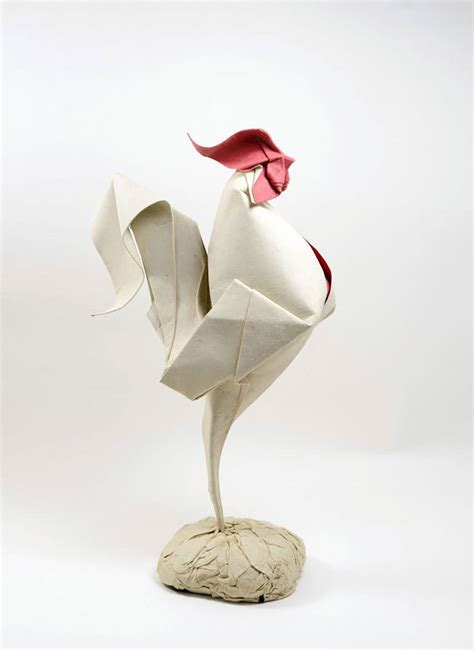 origami sculpture artist uses a special folding technique to give these