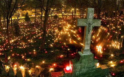 st s day lithuania cemetery lit up on all saints day photos