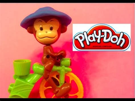 curious play play doh curious george the monkey a tricycle