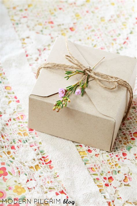 craft paper gift wrap simple gift wrap craft paper twine sprig of flowers