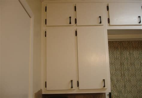 plain kitchen cabinet doors update plain kitchen cabinet doors by adding moulding