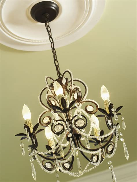 to ceiling chandelier how to install a decorative ceiling medallion hgtv