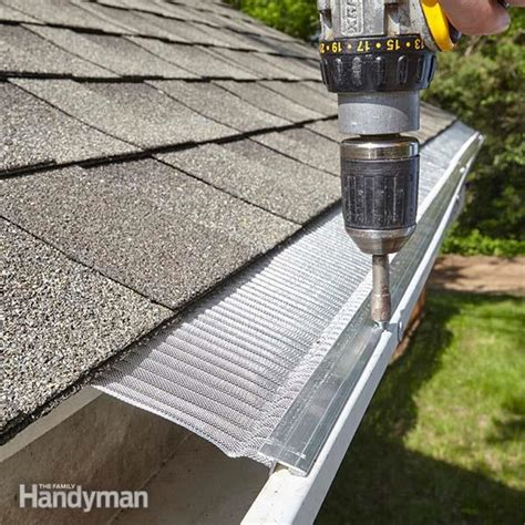 how to put gutters on a house gutter repair the family handyman