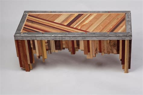 superior metal and woodwork made mixed wood table with salvaged steel edging by