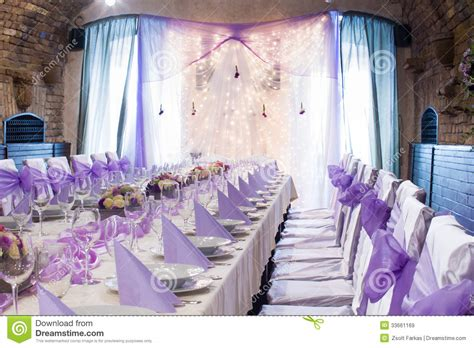 purple and white decorations table set for wedding or another catered event dinner