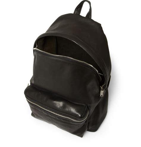 black leather backpacks laurent leather backpack in black for lyst