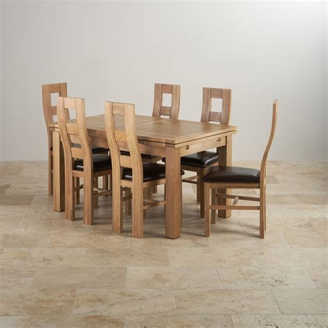 oak extending dining table and chairs dorset dining set extending table in oak 6 leather chairs