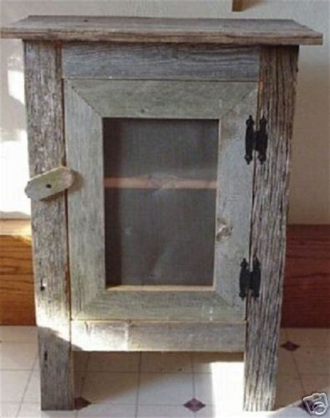 25 best ideas about barn wood cabinets on