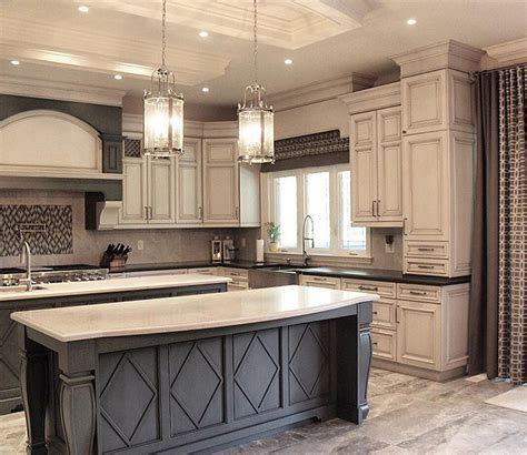pictures of kitchens with white cabinets and black appliances grey island with white countertop and antique white