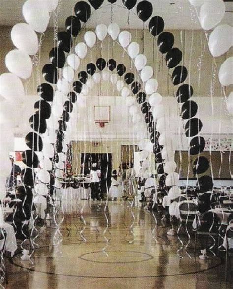 black and white theme these balloon arches with streamers would be great