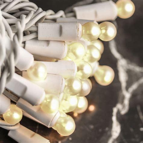 white cord string lights pearl white globe bulb and white cord string lights