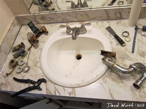 how to replace a kitchen sink bathroom sink how to install a faucet