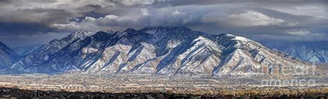 storm front passes over the wasatch mountains and salt