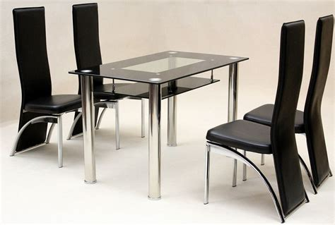 black dining tables and chairs heartlands vegas black glass dining table with 4 chairs