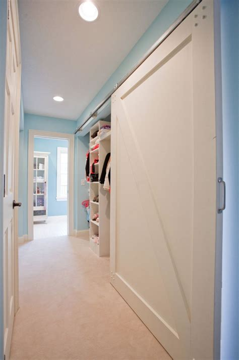 sliding barn style closet doors bringing sliding barn doors inside