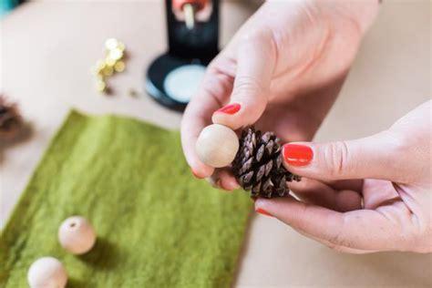 pine cone ornaments to make how to make mini pinecone ornaments hgtv
